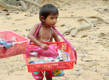Cambodian little boy sell souvenirs Royalty Free Stock Photos