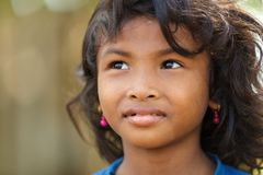 Cambodian little girl portrait. SIEM REAP, CAMBODIA, DECEMBER 04, 2012 : Cambodian little girl portrait in a village near Siem Reap, Cambodia Royalty Free Stock Image