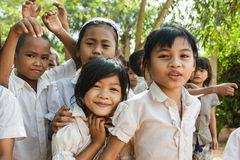 Cambodian little girl portrait. Cambodian students are posing in front of the school in a village near Siem Reap, Cambodia on December 04, 2012 Stock Photo