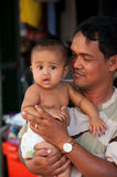 Cambodian man with baby Stock Images