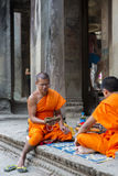 Cambodian monks sitting on stairs at Angkor Wat temple, Cambodia Royalty Free Stock Photos