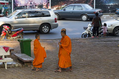 Cambodian monks walking on the street in Kampot Royalty Free Stock Photos