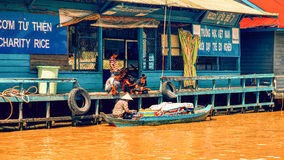 Cambodian people live on Tonle Sap Lake in Siem Reap, Cambodia. Cambodian food vendor on the Tonle Sap lake Royalty Free Stock Photo