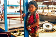 Cambodian people live on Tonle Sap Lake in Siem Reap, Cambodia. girl of Cambodia begs for money from tourists and show that she is Royalty Free Stock Photos