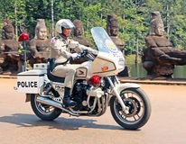 Cambodian Policeman. On a motorcycle Stock Photo