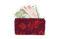 Cambodian Riel. In an embroidered silkwallet, isolated on white, with clipping path Stock Image