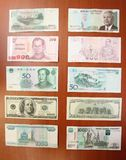Cambodian riel by five thousands (5000), Thai baht by hundred (100), Chinese yuans by fifty (50), United states dollars by hundred Royalty Free Stock Images