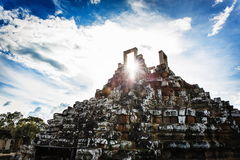 Cambodian temple ruins. Angkor Wat Cambodia. Khmer ancient Buddhist temple under the picturesque sky with clouds and sunlight. Famous landmark, place of worship Stock Images