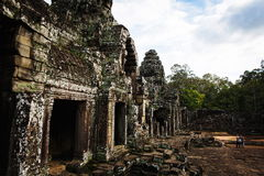 Cambodian temple ruins. Angkor Wat Cambodia. Khmer ancient Buddhist temple under the picturesque sky with clouds and sunlight. Famous landmark, place of worship Stock Photography