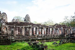 Cambodian temple ruins. Angkor Wat Cambodia. Khmer ancient Buddhist temple under the picturesque sky with clouds and sunlight. Famous landmark, place of worship Royalty Free Stock Photography