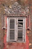 Cambodian window. A traditional temple window in need of repair Royalty Free Stock Images