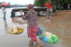 Cambodian woman carrying weights royalty free stock image