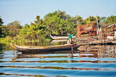 Cambodian woman floating in a boat Royalty Free Stock Photos