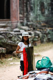 Cambodian woman folds scarves Angkor Wat market Royalty Free Stock Photos