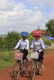Cambodian women on bikes Royalty Free Stock Photography