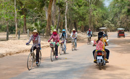 Cambodian women ride bicycles at Angkor Stock Photography
