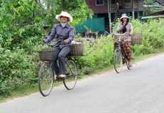 Cambodian women ride bycicle Stock Photo