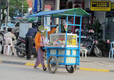Cambodian women sells food on the street Stock Photography