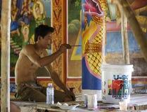 Cambodian young artist paints a temple near Kampot. Stock Photos