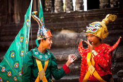 Cambodians in national dress poses for tourists in Angkor Wat Royalty Free Stock Photography