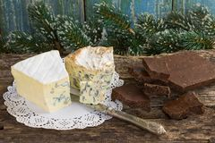 Cambozola, Bleu d`auvergne noble gourmet cheeses with blue and w Royalty Free Stock Photography
