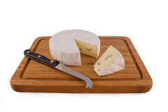Cambozola cheese on white Isolated background. A slice of Cambozola cheese on a wooden board with a knife for soft cheese Royalty Free Stock Images