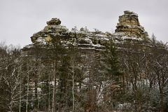Cambrian Sandstone Rock Formations. This is a Winter picture of Cambrian Sandstone Rock Formations during snow storm located in Central, Wisconsin.  Cambrian Stock Photo