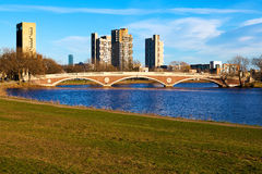 Cambridge. View of Cambridge in Massachusetts on a nice spring day with the Weeks Memorial Footbridge on the Background Royalty Free Stock Images