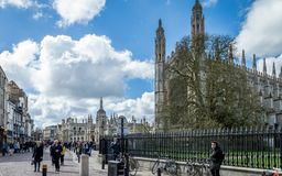 People walking down the streets of Cambridge on a busy sunny day in front of King`s College, Cambridge stock images