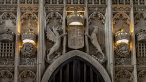 Architectural interior details of stone carved coat of arms above main entrance of Kings College Chapel stock photos