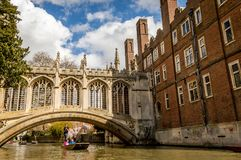 People punting on the Cam River, passing under the Bridge of Sighs over the River royalty free stock photo