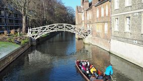 Cambridge, England. Tourists riding boat tours around the Cambridge University colleges along the river Cam. Cambridge, England. Tourists riding boat tours stock video