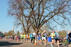 Cambridge Half Marathon. CAMBRIDGE, UK- MARCH 09, 2014: Runners in the third annual Cambridge half marathon, a charity fund raising event, in Cambridge Royalty Free Stock Image