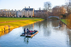 Cambridge, River Cam and tourist's boats at sunset Royalty Free Stock Image