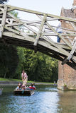 CAMBRIDGE, UK - AUGUST 18: Tourist punter in gondola in River Ca Stock Photos