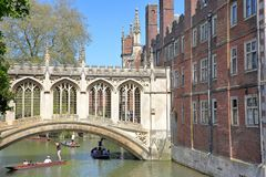The Bridge of Sighs at St John`s College University with tourists and students punting on the river Cam stock photography