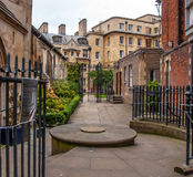 Cambridge UK University. A college of Cambridge University through the metal gate Stock Photography