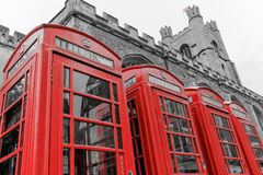 CAMBRIDGE, UNITED KINGDOM - APRIL 29, 2017: four iconic red K6 telephone boxes aside Great St. Mary`s Church. CAMBRIDGE, UNITED KINGDOM - APRIL 29, 2017: A row Stock Photo