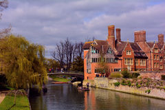 Cambridge university building and punting on river Cam, UK Stock Images