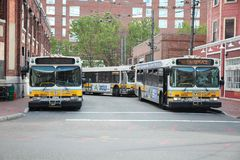 Boston buses. CAMBRIDGE, USA - JUNE 9, 2013: Boston city buses (MBTA Bus) in Cambridge, MA. MBTA Bus operates on 177 lines royalty free stock images