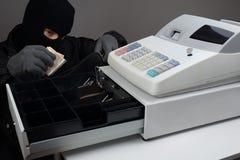 Cambrioleur Stealing Money Photos libres de droits