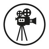 Camcorder in a circle on a white background. Movie camera on a tripod. Making a movie single icon in monochrome style symbol stock illustration web Royalty Free Stock Photos
