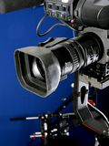Camcorder on crane. Dv camcorder stand on cinema crane with handly remote control with deep blue background Royalty Free Stock Photography