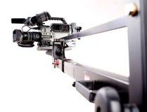 Camcorder on crane. Digital video camera recorder on black tv crane Royalty Free Stock Photography