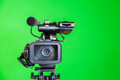 Camcorder on a green background. Filming in the interior. The chroma key.  Stock Photography