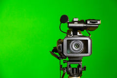 Camcorder on a green background. Filming in the interior. The chroma key.  Stock Photo