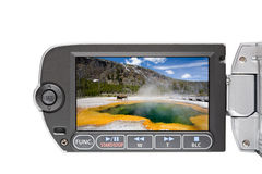 Camcorder LCD in Yellowstone. Camcorder LCD display screen with image of Emerald Pool in Yellowstone National Park, closeup isolated on white Royalty Free Stock Photo