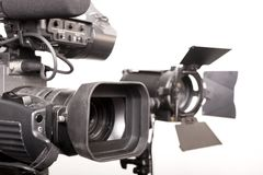 Camcorder and light. Close-up dv-cam camcorder and light source in studio Stock Photos