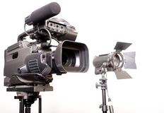 Camcorder and light Royalty Free Stock Photography