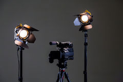 Camcorder and 2 spotlights with Fresnel lenses in the interior. Shooting an interview Stock Photos